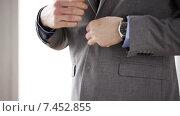 Купить «close up of man in suit fastening button on jacket», видеоролик № 7452855, снято 12 апреля 2015 г. (c) Syda Productions / Фотобанк Лори