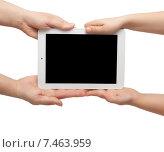 Купить «Руки взрослого и ребенка держат планшетный компьютер», фото № 7463959, снято 19 декабря 2013 г. (c) Элина Гаревская / Фотобанк Лори