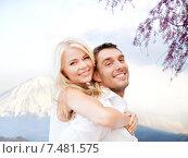 Купить «couple having fun over fuji mountain in japan», фото № 7481575, снято 14 июля 2013 г. (c) Syda Productions / Фотобанк Лори