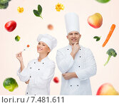 Купить «happy chef couple or cooks over food background», фото № 7481611, снято 7 марта 2015 г. (c) Syda Productions / Фотобанк Лори