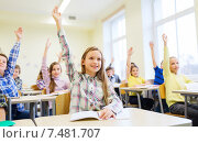 Купить «group of school kids raising hands in classroom», фото № 7481707, снято 15 ноября 2014 г. (c) Syda Productions / Фотобанк Лори