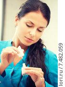 Купить «beautiful woman polishing her nails», фото № 7482059, снято 18 июня 2011 г. (c) Syda Productions / Фотобанк Лори