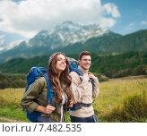 Купить «smiling couple with backpacks hiking», фото № 7482535, снято 31 августа 2014 г. (c) Syda Productions / Фотобанк Лори