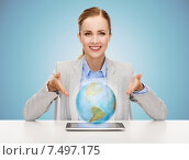 Купить «business woman with tablet pc and globe hologram», фото № 7497175, снято 19 января 2014 г. (c) Syda Productions / Фотобанк Лори