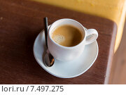 Купить «cup of black coffee with spoon and saucer on table», фото № 7497275, снято 13 февраля 2015 г. (c) Syda Productions / Фотобанк Лори