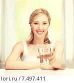 Купить «young smiling woman with glass of water», фото № 7497411, снято 17 июня 2012 г. (c) Syda Productions / Фотобанк Лори