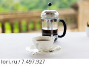 Купить «cup of coffee and french press on table», фото № 7497927, снято 21 февраля 2015 г. (c) Syda Productions / Фотобанк Лори