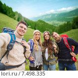 Купить «group of smiling friends with backpacks hiking», фото № 7498335, снято 31 августа 2014 г. (c) Syda Productions / Фотобанк Лори