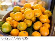 Купить «basket of fresh ripe juicy oranges at kitchen», фото № 7498635, снято 15 февраля 2015 г. (c) Syda Productions / Фотобанк Лори