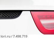 Купить «close up of car part with grille and headlight», фото № 7498719, снято 28 марта 2015 г. (c) Syda Productions / Фотобанк Лори
