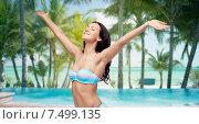 Купить «happy woman in bikini swimsuit with raised hands», фото № 7499135, снято 14 апреля 2015 г. (c) Syda Productions / Фотобанк Лори