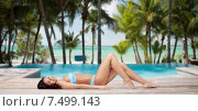Купить «happy woman in bikini tanning over summer beach», фото № 7499143, снято 14 апреля 2015 г. (c) Syda Productions / Фотобанк Лори