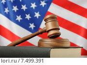 Купить «Американское правосудие - судейский молоток на фоне флага США», фото № 7499391, снято 23 мая 2015 г. (c) Денис Ларкин / Фотобанк Лори