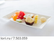 Купить «plate of fresh juicy fruit dessert at restaurant», фото № 7503059, снято 21 февраля 2015 г. (c) Syda Productions / Фотобанк Лори