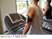 Купить «smiling men exercising on treadmill in gym», фото № 7503079, снято 28 сентября 2014 г. (c) Syda Productions / Фотобанк Лори
