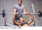 Купить «man and woman with barbell flexing muscles in gym», фото № 7503199, снято 19 апреля 2015 г. (c) Syda Productions / Фотобанк Лори
