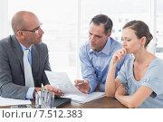 Купить «Businessman explaining contract to business partners», фото № 7512383, снято 15 марта 2015 г. (c) Wavebreak Media / Фотобанк Лори