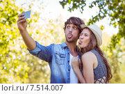 Купить «Hipster couple taking a selfie», фото № 7514007, снято 25 марта 2015 г. (c) Wavebreak Media / Фотобанк Лори