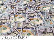 Купить «Фон из сто долларовых купюр», фото № 7515947, снято 30 ноября 2014 г. (c) Андрей Воробьев / Фотобанк Лори
