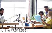 Купить «happy creative team with computers in office», видеоролик № 7519535, снято 2 апреля 2015 г. (c) Syda Productions / Фотобанк Лори