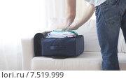 Купить «close up of man packing clothes into travel bag», видеоролик № 7519999, снято 18 апреля 2015 г. (c) Syda Productions / Фотобанк Лори