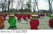 Купить «Ряды мемориальных свечей», видеоролик № 7522503, снято 27 марта 2015 г. (c) Потийко Сергей / Фотобанк Лори