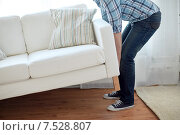 Купить «close up of male moving sofa or couch at home», фото № 7528807, снято 28 января 2014 г. (c) Syda Productions / Фотобанк Лори