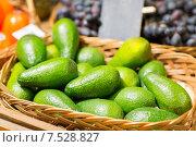 Купить «avocado in basket at food market», фото № 7528827, снято 20 декабря 2014 г. (c) Syda Productions / Фотобанк Лори