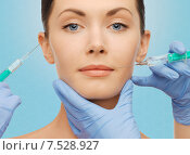 Купить «woman face and surgeon hands with syringes», фото № 7528927, снято 6 января 2013 г. (c) Syda Productions / Фотобанк Лори
