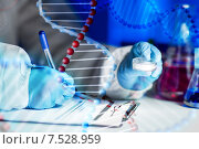 Купить «close up of scientist writing test results in lab», фото № 7528959, снято 9 декабря 2014 г. (c) Syda Productions / Фотобанк Лори