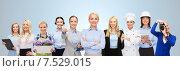Купить «happy businesswoman over professional workers», фото № 7529015, снято 29 января 2015 г. (c) Syda Productions / Фотобанк Лори