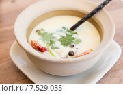 Купить «bowl of creamy soup with shrimps on table», фото № 7529035, снято 15 февраля 2015 г. (c) Syda Productions / Фотобанк Лори
