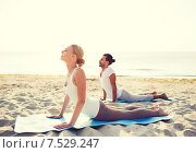 Купить «couple making yoga exercises outdoors», фото № 7529247, снято 6 августа 2014 г. (c) Syda Productions / Фотобанк Лори