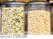 Купить «jars of peanuts and pumpkin seeds at grocery store», фото № 7529335, снято 20 декабря 2014 г. (c) Syda Productions / Фотобанк Лори