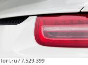 Купить «close up of car part with grille and headlight», фото № 7529399, снято 28 марта 2015 г. (c) Syda Productions / Фотобанк Лори
