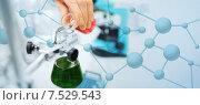 Купить «close up of scientist filling test tubes in lab», фото № 7529543, снято 4 декабря 2014 г. (c) Syda Productions / Фотобанк Лори