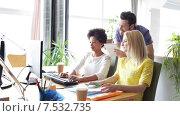 Купить «happy creative team with computers in office», видеоролик № 7532735, снято 2 апреля 2015 г. (c) Syda Productions / Фотобанк Лори