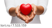 Купить «womans cupped hands showing red heart», фото № 7533159, снято 12 декабря 2013 г. (c) Syda Productions / Фотобанк Лори