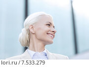 Купить «young smiling businesswoman over office building», фото № 7533279, снято 19 августа 2014 г. (c) Syda Productions / Фотобанк Лори