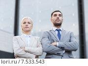 Купить «serious businessmen standing over office building», фото № 7533543, снято 19 августа 2014 г. (c) Syda Productions / Фотобанк Лори