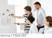 Купить «business team working with flipchart in office», фото № 7533707, снято 9 июня 2013 г. (c) Syda Productions / Фотобанк Лори