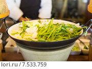 Купить «bowl of green salad or garnish at asian restaurant», фото № 7533759, снято 15 февраля 2015 г. (c) Syda Productions / Фотобанк Лори