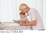 Купить «Smiling blonde woman with his son using digital tablet», фото № 7553431, снято 3 февраля 2015 г. (c) Wavebreak Media / Фотобанк Лори