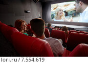 Купить «happy couple watching movie and talking in theater», фото № 7554619, снято 19 января 2015 г. (c) Syda Productions / Фотобанк Лори