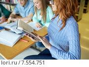 Купить «close up of students reading books at school», фото № 7554751, снято 6 марта 2015 г. (c) Syda Productions / Фотобанк Лори