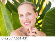 Купить «Beautiful blonde smiling at camera behind leaf», фото № 7561431, снято 11 февраля 2015 г. (c) Wavebreak Media / Фотобанк Лори