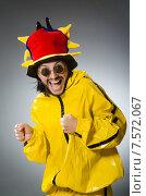 Купить «Man wearing yellow suit in funny concept», фото № 7572067, снято 22 апреля 2015 г. (c) Elnur / Фотобанк Лори