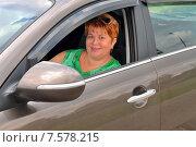 Купить «Женщина за рулем автомобиля», эксклюзивное фото № 7578215, снято 8 июля 2011 г. (c) Юрий Морозов / Фотобанк Лори