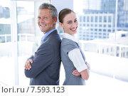 Купить «Two business colleagues standing back to back», фото № 7593123, снято 17 марта 2015 г. (c) Wavebreak Media / Фотобанк Лори