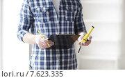 Купить «close up of man with measuring ruler and clipboard», видеоролик № 7623335, снято 28 марта 2015 г. (c) Syda Productions / Фотобанк Лори